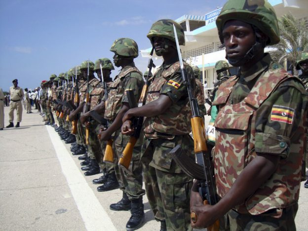African Union peacekeeping soldiers from Uganda parade during the arrival of Somalia's new president and former leader of the opposition Alliance for the Re-Liberation of Somalia Sheikh Sharif Ahmed in the capital Mogadishu February 7, 2009. Ahmed arrived in the Somali capital for the first time since he was elected President in neighbouring Djibouti a week ago. REUTERS/Feisal Omar (SOMALIA)